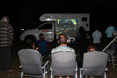 Conducting a screening of our work at McLean Beach Caravan Park